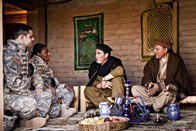 soldiers meeting with Afghan men